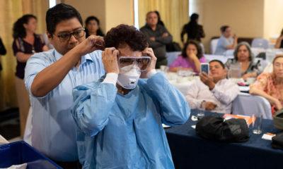 OPS-OMS/Victor Sanchez Trabajadores de salud reciben capacitación sobre el manejo de pacientes con coronavirus en Guatemala.